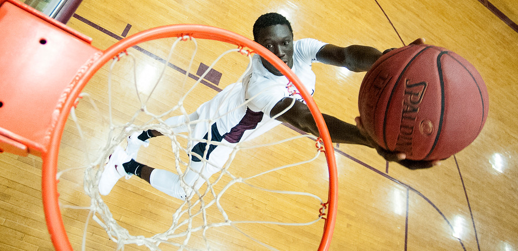 Edward Little High School basketball player Wol Maiwen dunks in the EL gym during a recent practice.