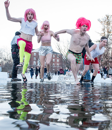 "Bates College students, from left to right, Ben Seaman, left, Mia Matlack, David Ingraham and Ben Stratton launch themselves into Lake Andrews during Friday afternoon's annual ""Puddle Jump"" into on the campus of Bates College in Lewiston, Maine on February 8, 2019. Visit sunjournal.com to watch a video of the event. (Sun Journal photo by Russ Dillingham)"
