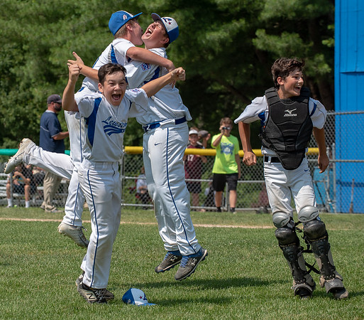 Lewiston relief pitcher Ethan Blue, center, reacts after recording the final out in his team's 8-4 victory over York Saturday at Elliot Avenue Little League Field in Lewiston to capture the state championship and advance to the regional finals in Connecticut where they will take on Massachussetts on Sunday.  Behind Blue, left to right are Jeffrey Randall, Joe Dube and Mike Caron.