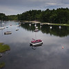 Peter Davis steps walks away from his boat in the area he once parked his float plane but can no longer maneuver it through the maze of boats anchored in front of the Androscoggin Yacht Club across the way on Androscoggin Lake in Wayne Tuesday morning, July 28, 2020.