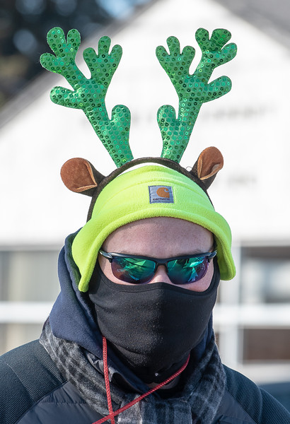 An unidentified parade participant is bundled up for the cold as they make their way down Paris Street Saturday morning in Norway.