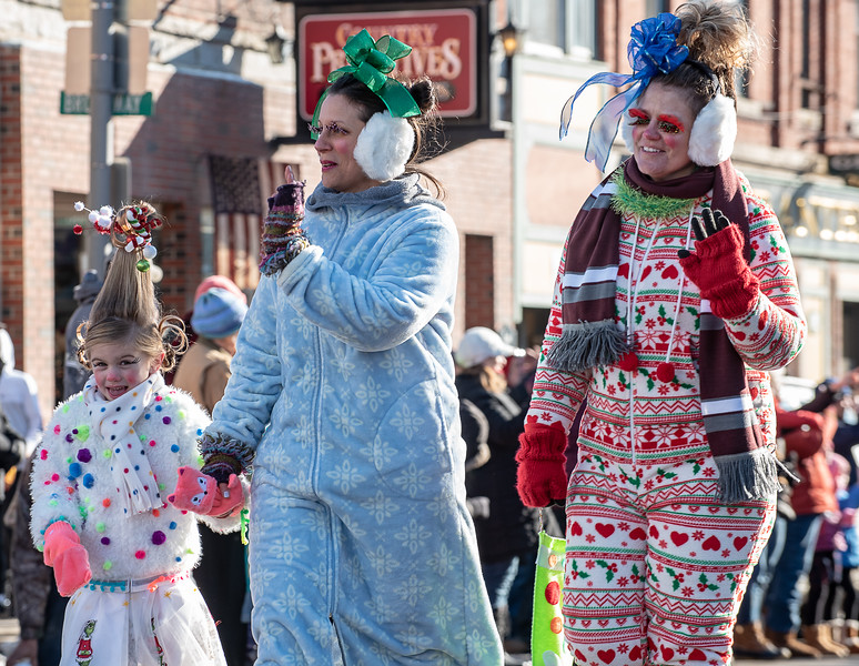 """Several floats, and participants in Saturday's Chester Greenwood Day Parade in Farmington, Maine dressed up like characters from the movie """"The Grinch That Stole Christmas,"""" like these from Key Insurance company located on the same street."""