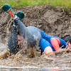 Molly and Patrick Kimball, of Augusta, got a faceful of muddy water as they make their way through the course Saturday, October 12, 2019 at Sunday River in Newry, Maine during the North American Wife Carrying Competition.  The couple from Augusta, Maine shook it off and finished the course with a respectable time.