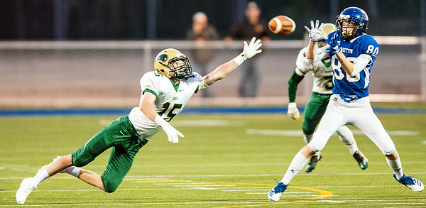 Oxford Hills' linebacker Parker LaFrance dives for a pass and just tipped it enough to prevent Lewiston's Lucas Nichols from making a catch during the first half of Friday night's football game in Lewiston. (Russ Dillingham/Sun Journal)