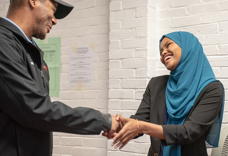 Ward 1 city council candidate Safiya Khalid greets a voter at the Lewiston Armory Tuesday morning.