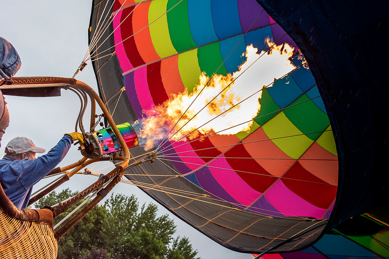 Neon Dreamz pilot Patrick Grogan of North Carolina fires up his balloon at  Simard-Payne Memorial Park in Lewiston Saturday morning during the Great Falls Balloon Festival.  Two balloons inflated but were taken down quickly as a light rain grounded the 3rd scheduled launch in a row at the start of the 2019 festival that continues through Sunday with morning and evening launches at 6:00.