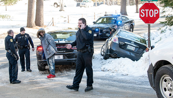 A suspect is taken into custody at the corner of North Hatch Hill Road and Sawyer Road in Greene, Maine Wednesday morning after a chase through several area towns before he crashed into the ditch at right.  (Sun Journal photo by Russ Dillingham)