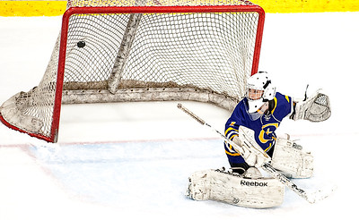Chevrus/Kennebunk goalie Anna Marie Smith looks back in time to see Courtney Sullivan's blast hit the back of the net for the first goal of the game in the second period.  (Russ Dillingham/Sun Journal)