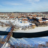 The three downtown bridges between Lewiston and Auburn can be seen from this aerial photo as the partially frozen Androscoggin River meanders through the Twin Cities Wednesday afternoon.  (Russ Dillingham/Sun Journal)