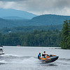 Two people on a personal watercraft jump the wake of a boat while staying cool on Wilson Lake in Wilton Monday afternoon.