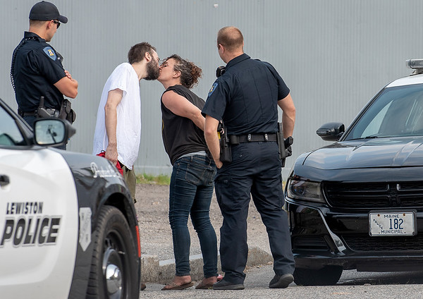 Nicole Simond, 35, of Lewiston, kisses a friend goodbye on Pierce Street in Lewiston Wednesday afternoon after being arrested on a warrant.