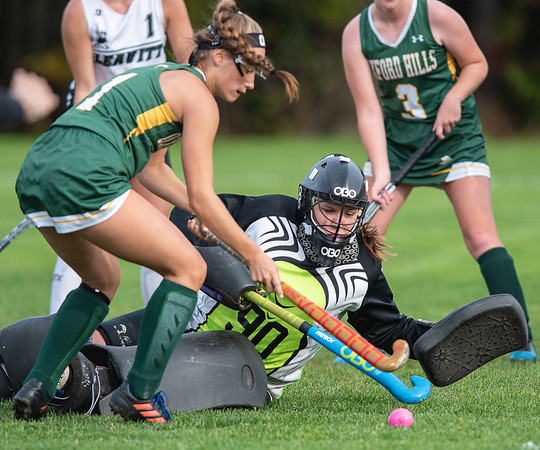 Leavitt goalie Paige DeMascio makes one of several spectatular diving saves as Oxford Hills' Brooke Carson fires a point blank shot on her during the first half of Tuesday's game in Turner.