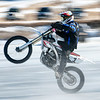 "Giuseppe Bonnano, 12, pops a wheelie as he flies across Sabattus Pond Sunday morning with a bunch of ""hooligans"" racing.  Visit sunjournal.com to watch racing from a racer's perspective.  (Sun Journal photo by Russ Dillingham)"