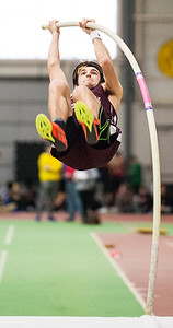 Edward Little's Alex Thompson heads for the bar during Saturday's KVAC meet at Bowdoin.  He set a new school record on this jump after vaulting past all the other competitors to win the event.   (Russ Dillingham/Sun Journal)
