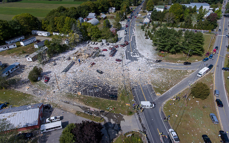 An aerial view of the devistation after an apparently accidental explosion at the Life Enrichment Advancing People (LEAP) building, 313 Farmington Falls Road, in Farmington, Maine killed one firefighter and injured seven other people, including a NorthStar Ambulance employee on Monday morning September 16, 2019. . The injured have been transported to multiple hospitals in Maine and Massachusetts.