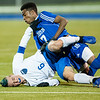 Mt. Ararat's Max Spelke, left and Lewiston's Jama Abdullahi get tangled up going for the ball during Wednesday's championship game in Lewiston.  (Russ Dillingham/Sun Journal)