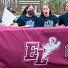 Emma Hefty, center, reacts after a gust of wind blew the letter of intent off the table that she just finished signing   in front of the Auburn school on November 10, 2020.  The 3 sport athlete will be swimming for D1 Merrimack College.  Attending with her from left to right are brother, Brooks, mother Rebecca, Emma and father, Michael, right.