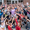 Principal Christine Lajoie-Cameron, center, is surrounded by the majority of the last 5th grade class she will see graduate in front of their school last week where she will be retiring from Carrie Ricker School in Litchfield.