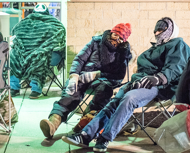 """Black Friday shoppers at Kohls in Auburn bundled up as they wait in the front of the line Thursday night. Pat Conrad of Lewiston, left, was """"roped into"""" joining her friend and co-worker to check out the Black Friday experience for the first time."""