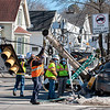 A vehicle toppled a utility pole at the corner of Pleasant Street and East Avenue in Lewiston  early Friday afternoon.  According to witnesses at the scene there was a man driving and a child in a car seat in the back.  Both were taken to the hospital with non life threatening injuries.