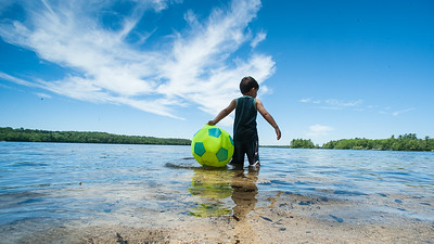 Friends and families enjoy the beautiful weather at Tripp Lake Beach in Poland Thursday afternoon.  (Russ Dillingham/Sun Journal)