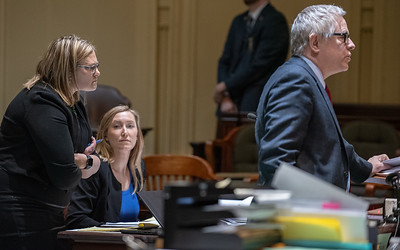 State of Maine Assistant Attorney General, Lisa Bogue, left, glares at  Justice William Stokes to show her displeasure with the argument defense attorney Jim Howaniec was making during Thursday's bail hearing for Gage Dalphonse in Androscoggin County Court in Auburn.  In the background is Assistant District Attorney Katherine Bozeman.