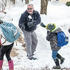 "Norway Detective Gary Hill, center is about to get hit by a snowball as Sierra Powell, blue backpack and pink boots, blocks a giant snowball that he tossed at her while walking home from school on Whitman Street in Norway Thursday afternoon.  Chief Robert Federico, left and the fire chief usually join the group of students from Guy E. Rowe Elementary School every day as they walk to and from school.  ""It's fun and it teaches us to be safe and responsible."" said Powell.  center, blocks a snowball that (Russ Dillingham/Sun Journal)"