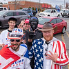 Brandon Caron, left of Standish, Maine and Joseph Pearson, of Buxton, Maine, foreground right, pose with others where several dozen vehicles, most with flags, signs and banners supporting President Trump, met at the former Kmart parking lot in Auburn, Maine before parading through Auburn and into Lisbon and ending in front of the courthouse on Lisbon Street in Lewiston where they held a rally on November 1, 2020.