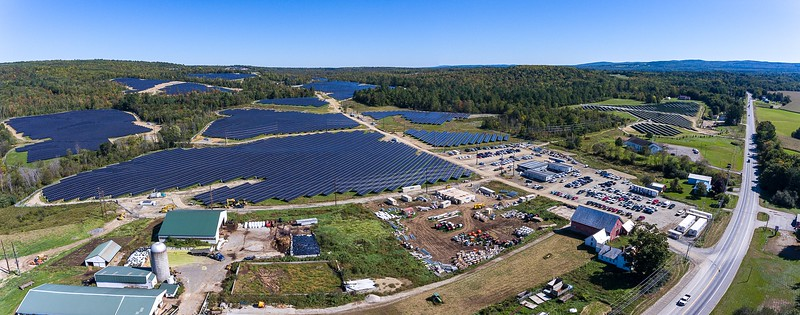 An aerial view on Sept. 20 shows the massive 490-acre, $110 million, 76.5-megawatt solar farm that Farmington Solar, LLC, a subsidiary of NextEra Energy Resources is building and nearing completion. Farmington will be receiving about $20 million in taxes during the course of the 30-year lease agreement.  Sandy River Farm, lower left, at 560 Farmington Falls Road/Route 2, in Farmington, is renting about 500 acres of farmland to NextEra Energy where 300,000 solar panels are being erected.  Like many farmers around the country, Sandy River Farm owner Bussie York has turned to alternative uses for their farmland in order to stay afloat. Visit sunjournal.com to watch a video flyover of the project.