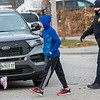 Children are escorted from their apartment building on Horton Street during Wednesday's search for a suspect involved in a shootout with Lewiston police on November 18, 2020.