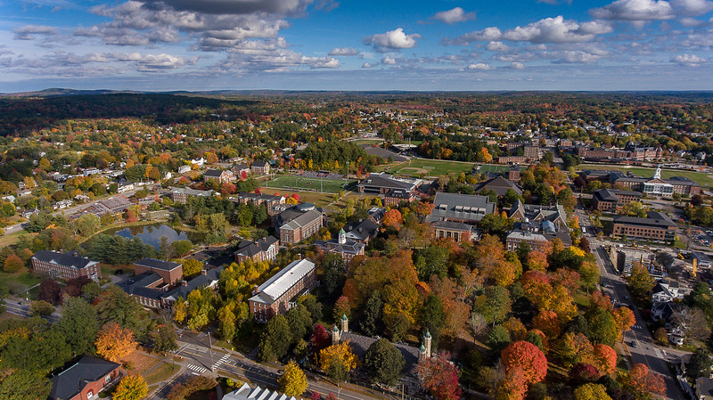The foliage in the quad at Bates College in Lewiston, botom right is starting to peak as the womens soccer team takes on University of Maine Farmington in the middle of the photo Sunday afternoon, October 13, 2019 in Lewiston, Maine.