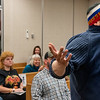 Paul Gokukin addresses the county commissioners during Wednesday night's meeting at the Androscoggin County Building in Auburn.  He was demonstrating how his shirt is as effective as a cloth mask against the coronavirus and believes they are basically useless, rendering the mask mandate ineffective.