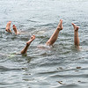 Friends and family staying cool and playing in the water at Lake  Pennesseewasse Park in Norway Wednesday afternoon do a hand stand together.