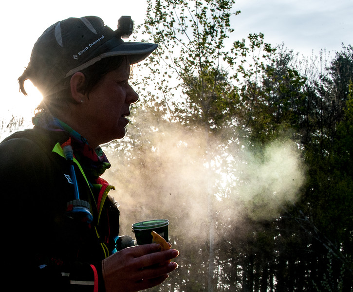 Stephanie Leblanc, of Madison is surrounded by steam coming off her body and from her breath at the finish of the Riverlands 100 & Relay at Riverlands State Park in Turner Sunday morning.  (Russ Dillingham/Sun Journal)