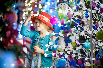 Elsa Hogate, 5, of Farmington, looks up at the decorated trees on display at the annual FEZtival of Trees at the Kora Temple in Lewiston, Maine on Saturday, November 17, 2018.  Check korashriners.org for when they will be open through Christmas. (Russ Dillingham/Sun Journal)