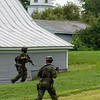 The state tactical team searches a Wilton, Maine neighborhood Monday afternoon, July 27, 2020 for Derrell D. Guy.