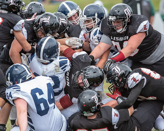 Lisbon Greyhounds gang tackle Fryeburg's Bryce Micklon as he tries to get into the endzone during Saturday's game in Lisbon.