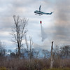 A Maine Forest Service helicopter dumps water on a large brush fire off Intervale Road in New Gloucester, Maine on Tuesday afternoon, May 5, 2020.