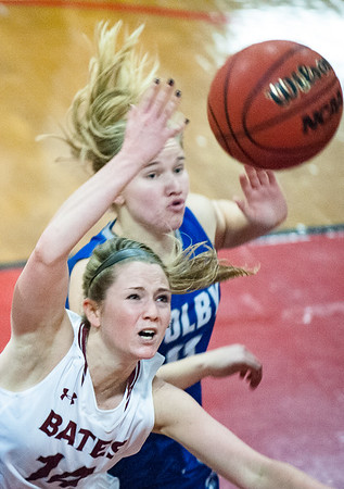 Bates' Emily Freedland, bottom battles Colby's Paige Russell for a rebound during Tuesday night's game in Lewiston.  (Russ Dillingham/Sun Journal)