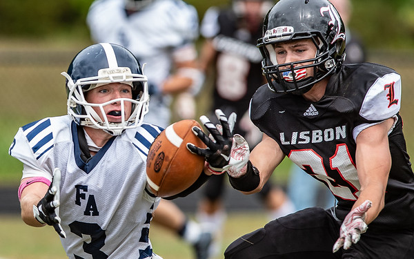 Neither Fryeburg's Dawson Jones, left or  Lisbon's Dayton McIver can come up with the ball on one of the last Hail Mary pases of the game as Lisbon was deep in their end with little time remaining on the clock.
