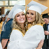 Saint Dominic Academy seniors Callie Samson, left, gives her cousin Madison Samson a big hug as the two try to calm their nerves prior just prior to marching into the school gymnasium Friday night's graduation. (Russ Dillingham/Sun Journal)