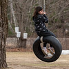 Malina Peters plays on the tire swing at her home in Oxford, Maine on March 31, 2021.  Her mother, watching from the driveway said she gets plenty of exercise between the tree swing and a trampoline.