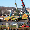 A crane lowers the Vietnam era Corsair jet onto it's pedestal in Veterans Memorial Park in Lewiston on  November 14, 2020.