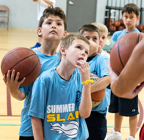 Youngsters listen to instructions during Sunday's Troy Barnies Pop-Up Basketball Clinic at the Hasty Memorial Armory in Auburn.  (Russ Dillingham/Sun Journal)