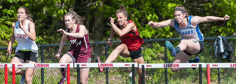 Mountain Valley's Lauren Sterling, right, is first over the hurdle and was first to cross the finish line setting an MVC record in the 110 meter hurdles during Thursday's MVC Championships in Lisbon.  From left to right are Destiny Deschaines, Lisbon, Emily Grandahl, Monmouth, Ayanna Stover, Wiscasset and Sterling.(Russ Dillingham/Sun Journal)