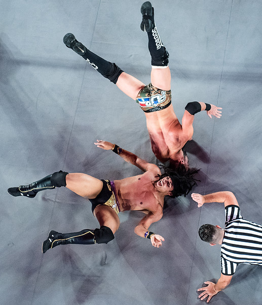 Eli Isom, bottom left, flips off Flip Gordon before the referee can count him out during Wednesday night's Ring of Honor - Global Wars event at the Androscoggin Bank Colisee in Lewiston. (Russ Dillingham/Sun Journal)