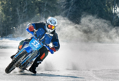 "Jon Dillingham, of Poland, slides around Sabattus Pond in Wales Sunday morning with a group of ""Hooligans"" as he warms up for a day of ice racing with a group of friends.  Several said they ""have a sickness whith motorcycle racing and we just want to come out and have some fun and try nto to killing each other doing it.""  Visit sunjournal.com to watch them racing from a racers perspective. (Sun Journal photo by Russ Dillingham)"