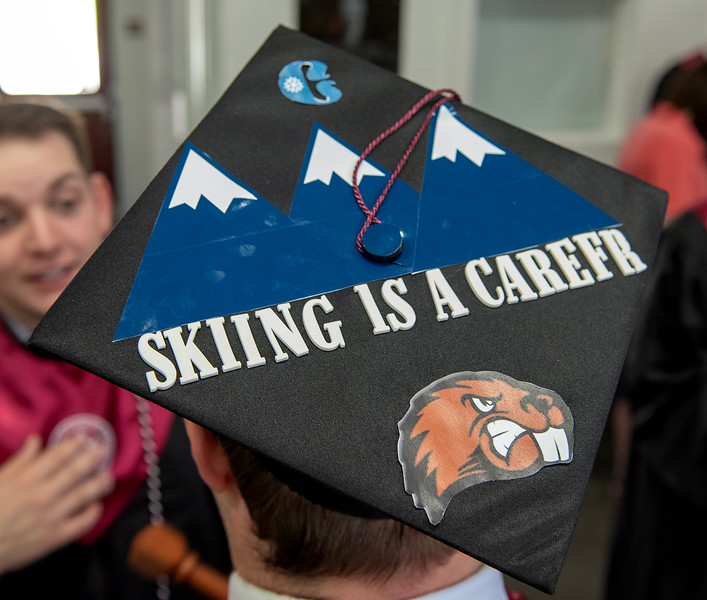 More than half the students graduation from UMF Saturday morning decorated their mortarboards for the ceremony.