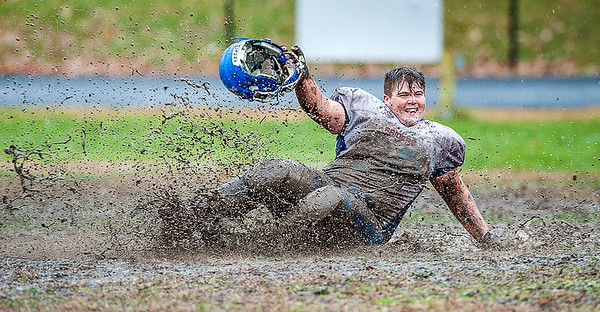 Oak Hill High School's James Borkowski, Jr. slides through the mud after the Raiders defeated rival Lisbon High School in overtime of their playoff game Saturday October 27, 2018 in Lisbon, Maine. (Russ Dillingham/Sun Journal)