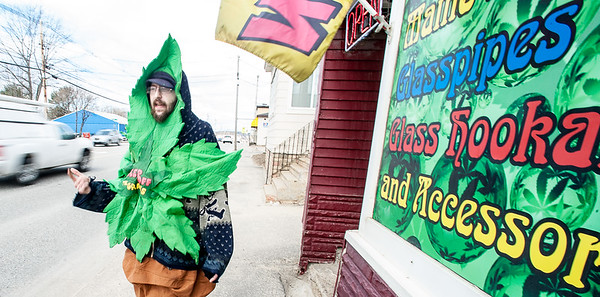"Devin Urquart, of Lewiston, whose alias is ""Blunt Man"" dances in front of Legal Peaces, a headshop on Lisbon Street in Lewiston Friday morning.  ""It's 4/20, my favorite holiday and I'm just rocking out here to get some attention for the business."" Urquart said. 4:20, or 4/20 is a code-term in cannabis culture that refers to the consumption of cannabis, especially smoking cannabis around the time 4:20 p.m. (Russ Dillingham/Sun Journal)"
